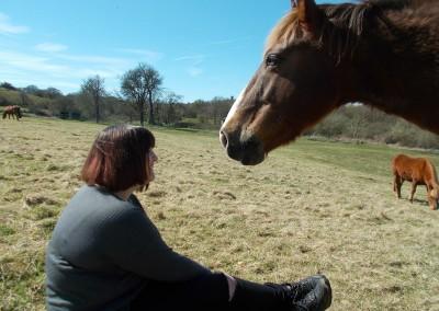 Lady sat on ground with pony
