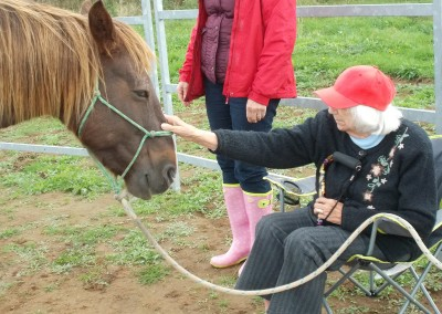 Learner sat in chair interacting with pony